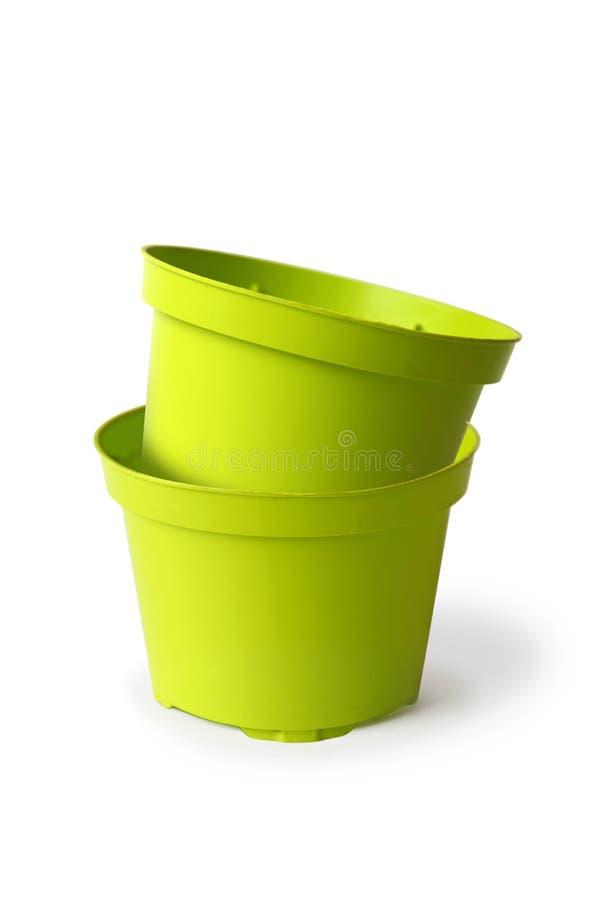 Deux pots en plastique d'usine photos stock