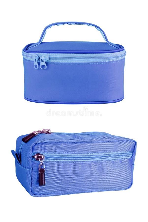 Deux sacs cosmétiques bleus de voyage, d'isolement sur le fond blanc chemins de découpage compris images stock