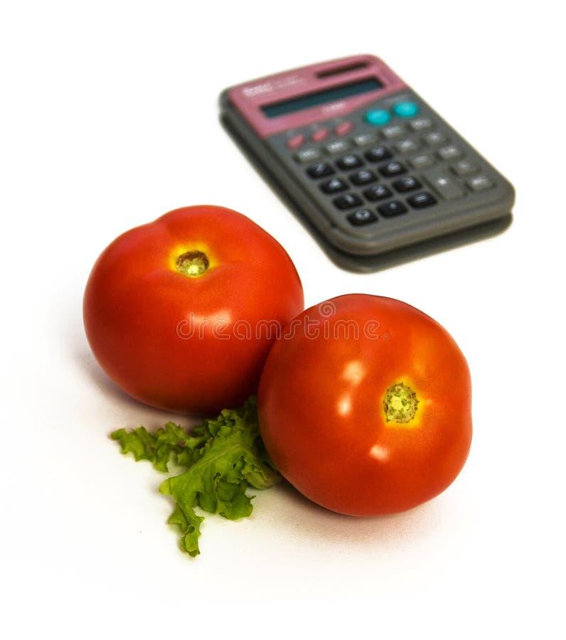 Deux tomates et calculatrices images stock