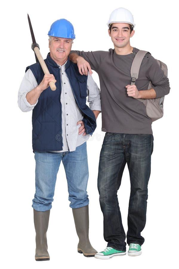 Deux travailleurs de la construction image stock