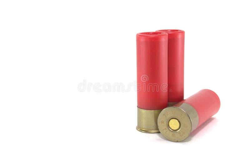 Deux vieilles cartouches pour le fusil de chasse sur le plan rapproché blanc de fond photographie stock