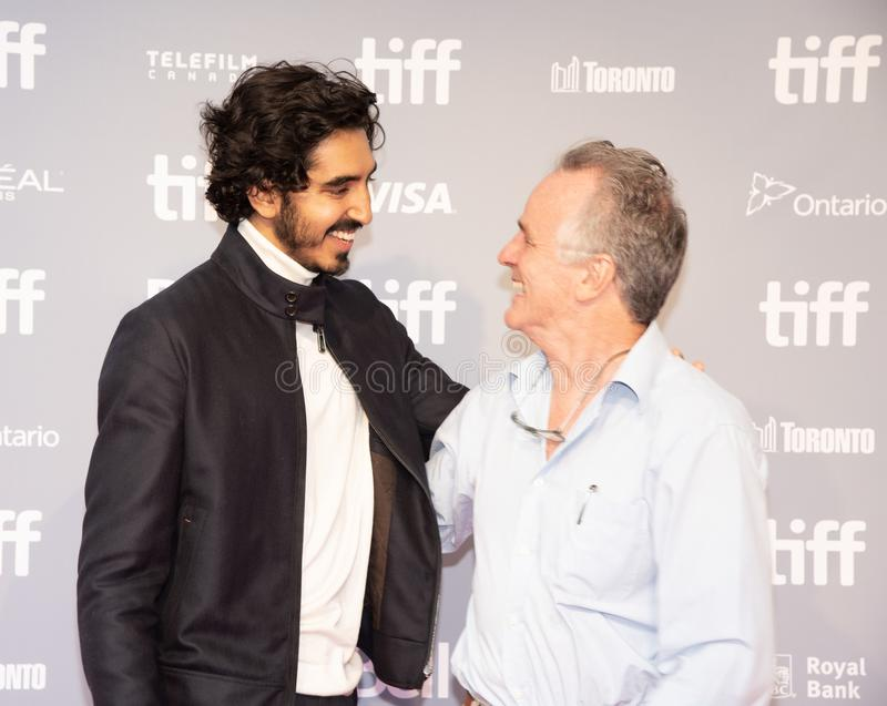 Dev Patel with writer John Collee press conference for Hotel Mumbai Toronto International Film Festival. Dev Patel with writer John Collee press conference 2018 royalty free stock image