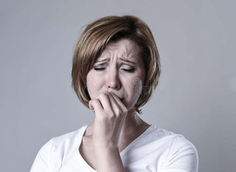 Devastated depressed woman crying sad feeling hurt suffering depression in sadness emotion stock image