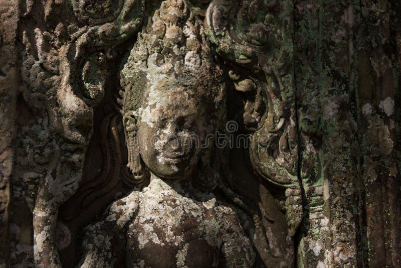 devata (神)的细节在吴哥窟,柬埔寨寺庙雕刻了  图库摄影