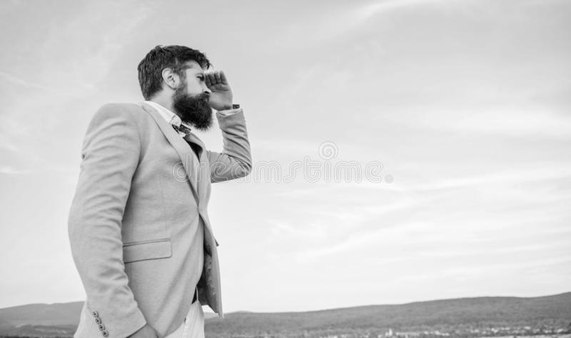 Developing business direction. Businessman bearded face sky background. Changing course. New business direction. Looking royalty free stock photo