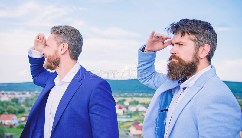 Developing business direction. Men formal suit managers looking at opposite directions. Changing course. New business stock photo