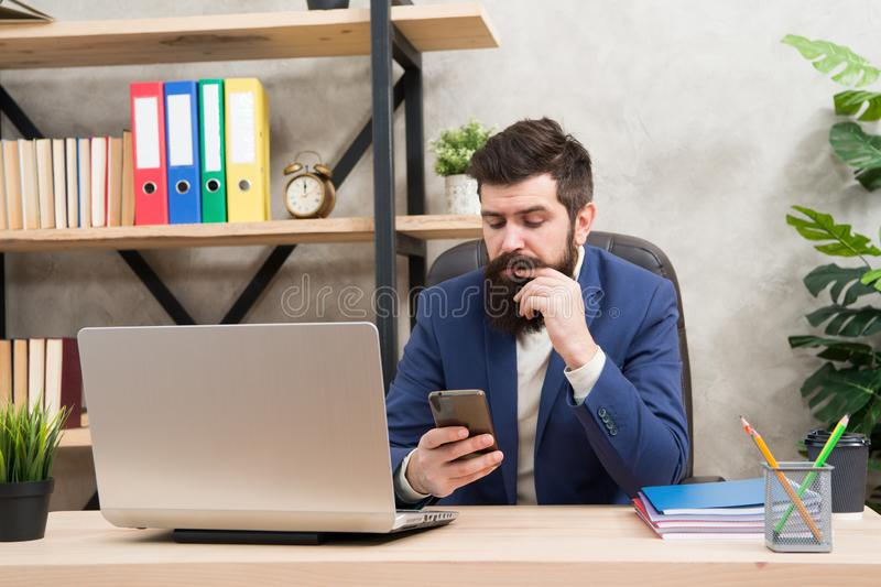 Developing business strategy. Risky business. Surfing internet. Man bearded boss manager sit office with laptop. Manager. Solving business problems. Businessman stock images