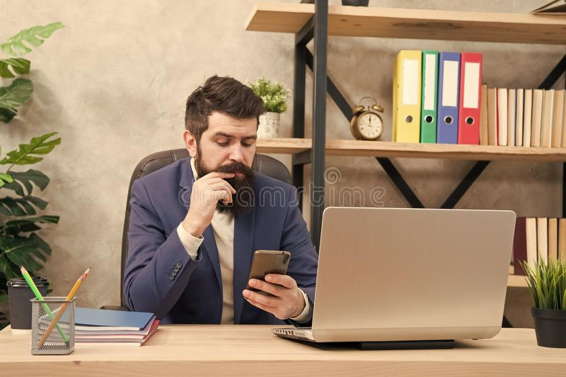 Developing business strategy. Risky business. Surfing internet. Man bearded boss manager sit office with laptop. Manager. Solving business problems. Businessman stock image