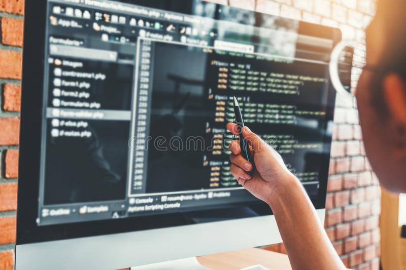 Developing Concentrated programmer reading computer codes Development Website design and coding technologies.  royalty free stock photo