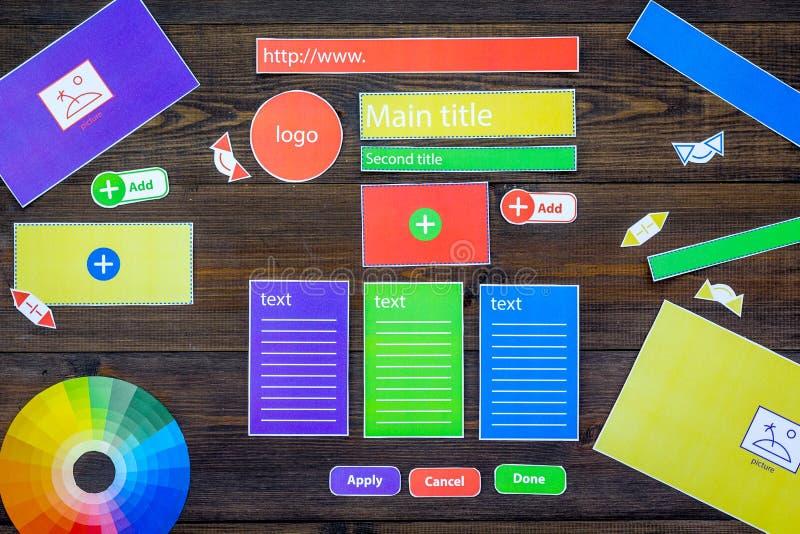 Developing internet site. Website design concept. Elements, blocks, instruments, tools for make site on dark wooden stock photo