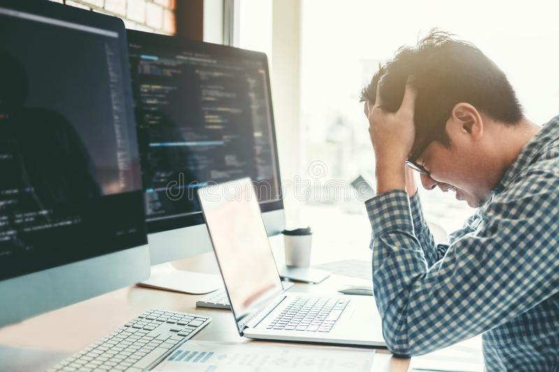 Developing programmer stressed out of work. Development Website design and coding technologies working in software company office stock images