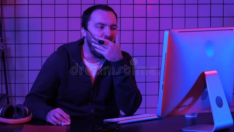 Developing programming and coding technologies. Bored programmer working. royalty free stock image