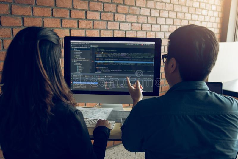 Developing programming and coding technologies working in a software engineers developing applications together in office royalty free stock photos
