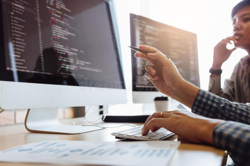 Developing programming and coding technologies working in a software engineers developing applications together in office royalty free stock images