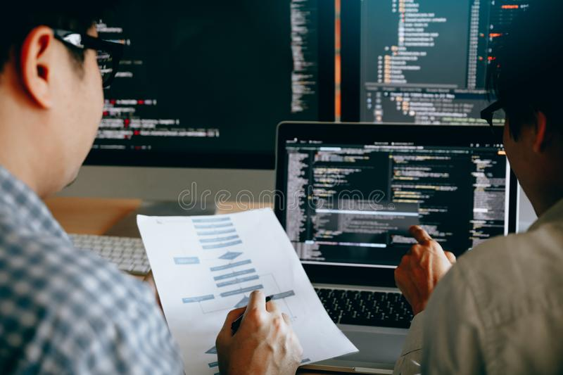 Developing programming and coding technologies working in a software engineers developing applications together in office royalty free stock image