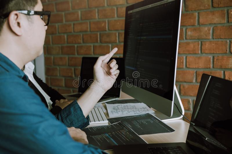 Developing programming and coding technologies working in a software engineers developing applications together in office stock photography