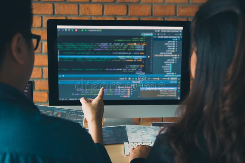Developing programming and coding technologies working in a software engineers developing applications together in office royalty free stock photo
