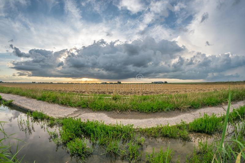 Stormy clouds over the dutch landscape. Fisheye view. stock image