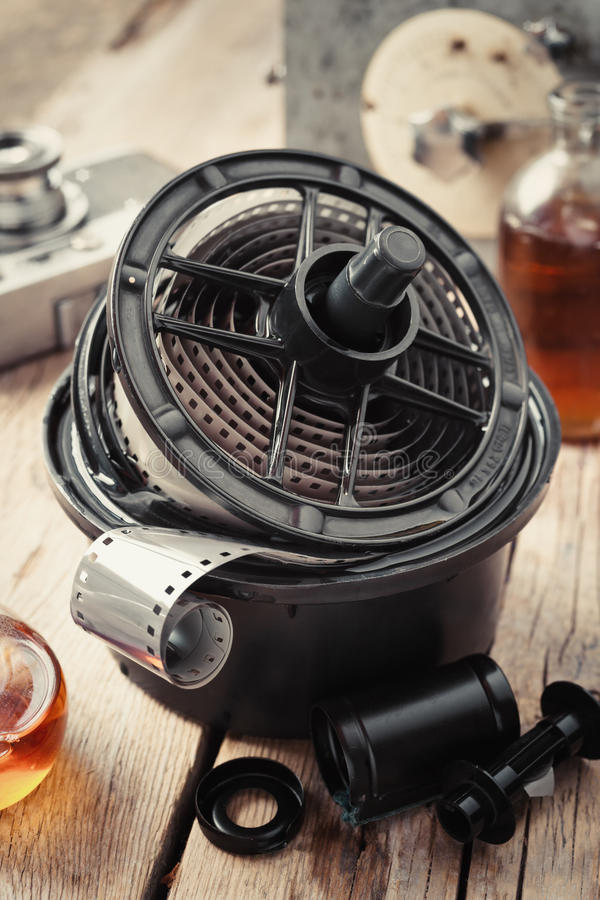 Developing tank with film reels, photo film rolls and cassette royalty free stock images