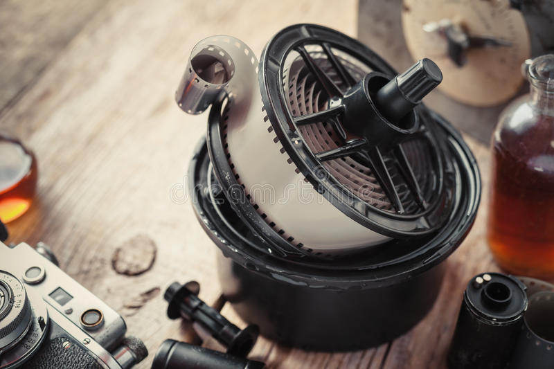 Developing tank with its film reels, photo film and camera royalty free stock photos
