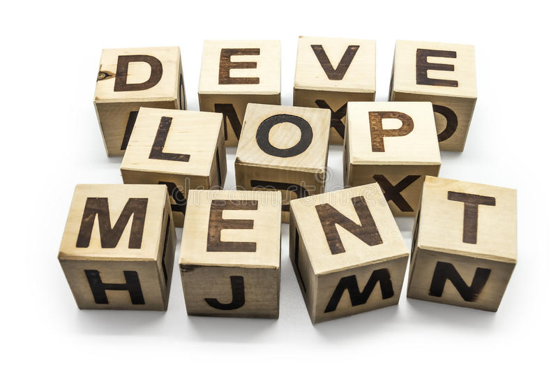 Development. Photo of wooden letter blocks forming the word Development on the white background
