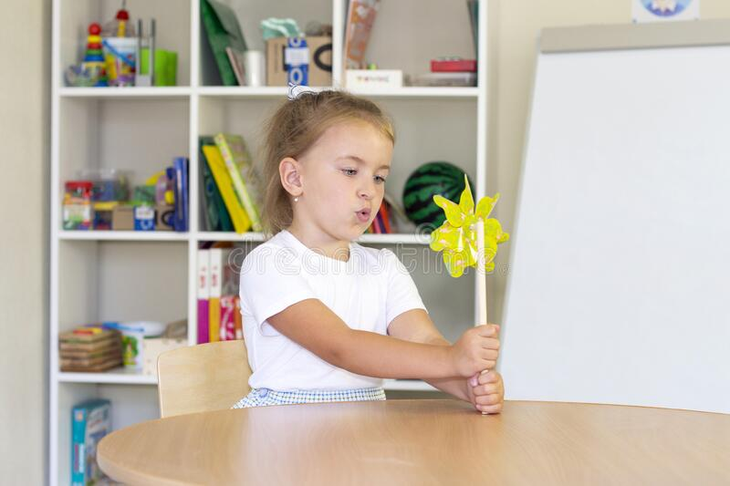Developmental and speech therapy classes with a child-girl royalty free stock image