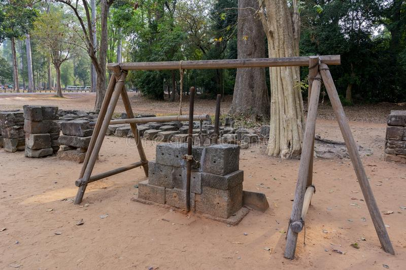 The device of the ancient builders for grinding stones. Angkor wat. Cambodia. Device ancient builders for lapping stones before laying in the walls of buildings royalty free stock photos