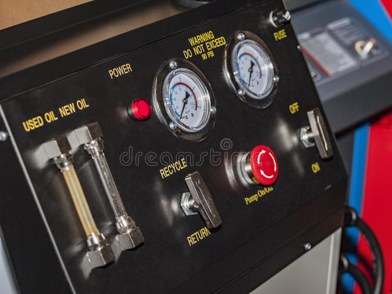 The device for the maintenance of vehicle systems. The device buttons and pressure gauges for measuring pressure in the vehicle system royalty free stock photos