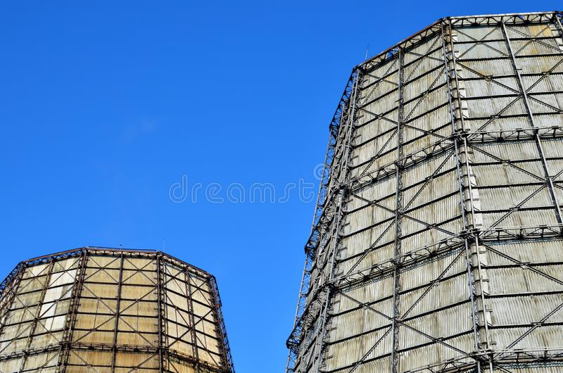 Device for cooling a large amount of water by a directed stream of atmospheric air. Steam piping with thermal insulation in Boiler of power plant on the blu royalty free stock photo