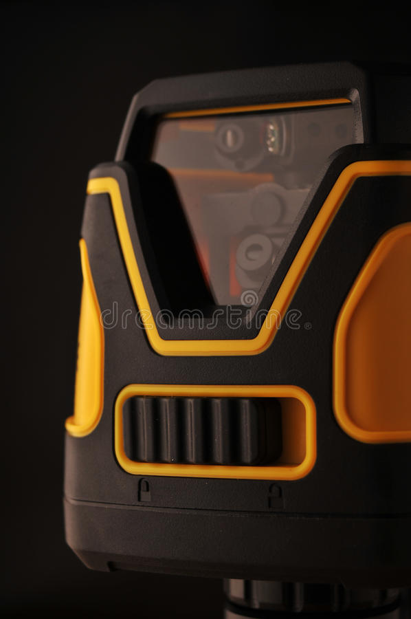 Device laser level. On black background royalty free stock photos
