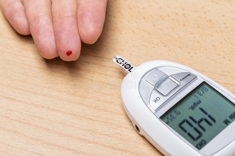Device for measuring cholesterol, and insulin. Blood test. Close up stock image