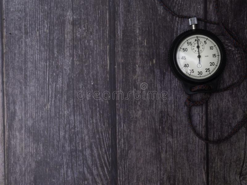 The device for the precise measurement of time intervals. Manual mechanical stopwatch. On wooden background, copy space stock image