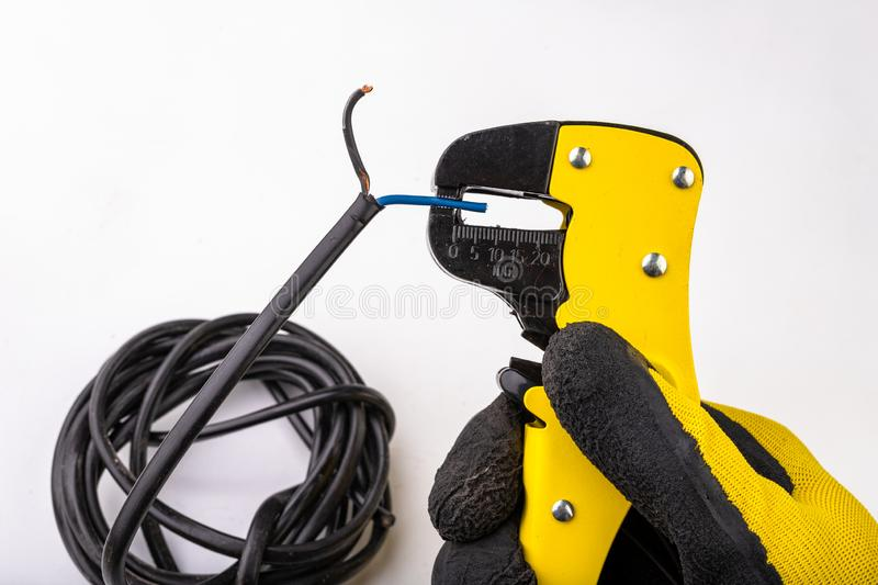 Device for removing insulation from electric cables. Accessories for the electrical installer stock photos