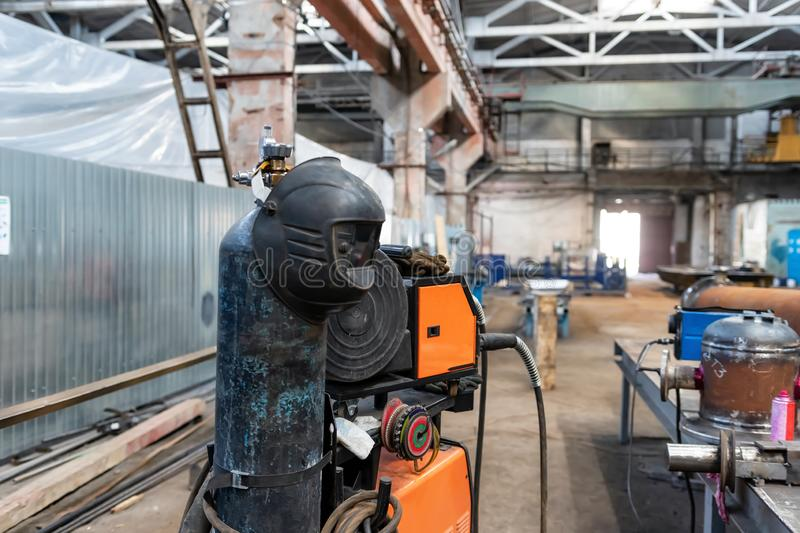Device for semi-automatic welding in the environment of protective gases. The device for semi-automatic welding in the environment of protective gases is in a stock photography
