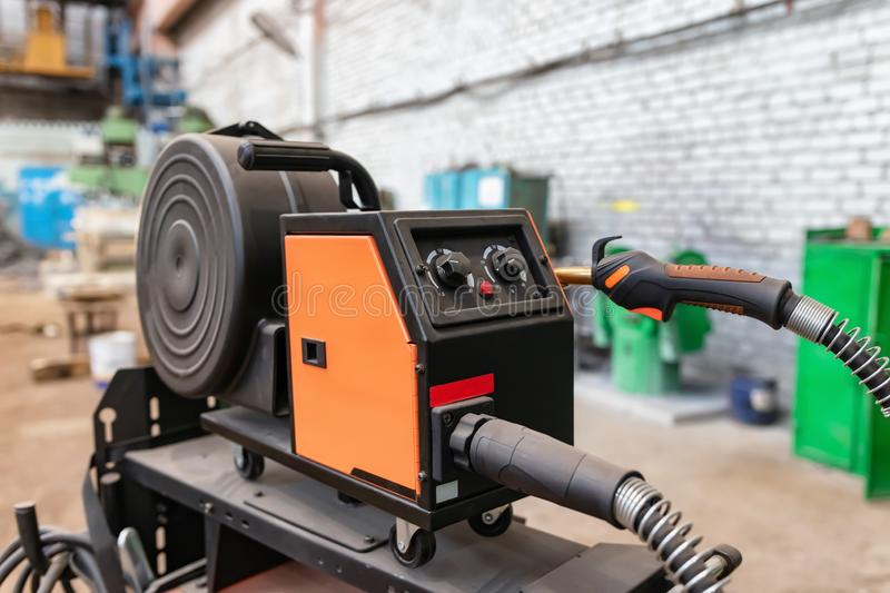 Device for semi-automatic welding in the environment of protective gases. The device for semi-automatic welding in the environment of protective gases is in a stock image