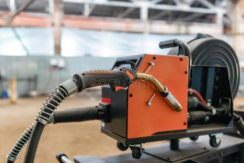 Device for semi-automatic welding in the environment of protective gases. The device for semi-automatic welding in the environment of protective gases is in a royalty free stock photo