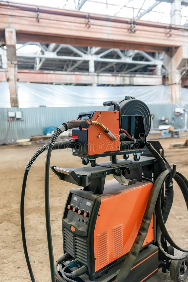 Device for semi-automatic welding in the environment of protective gases. The device for semi-automatic welding in the environment of protective gases is in a stock photos