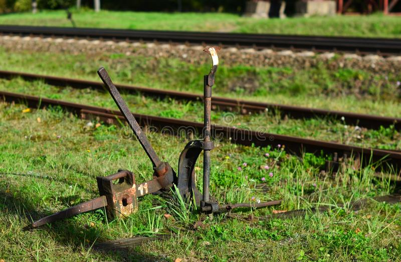 Switch translations of a rail, the mechanism with a manual control stands on the street royalty free stock images