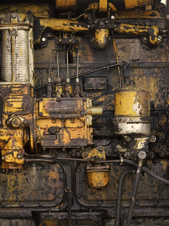 Device, tool, gear. Old technology, vintage. Machinery with oil dirt on grunge metal background. Factory, manufacture equipment Industry engineering machine stock photography