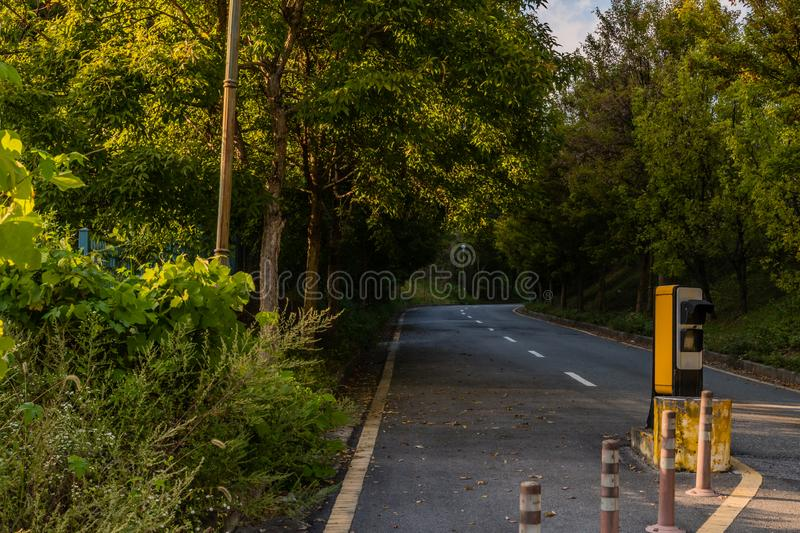 Device used to read license. Traffic monitor device used to read license plates on two lane paved road in industrial park royalty free stock photography