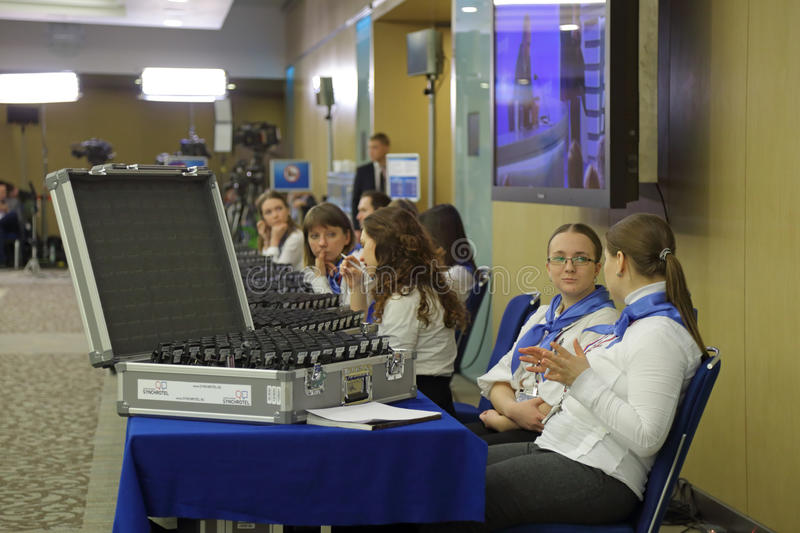 Devices for simultaneous translation. MOSCOW, RUSSIA - DEC 23, 2016: Center of international trade. Distribution of devices for simultaneous translation at the stock photos
