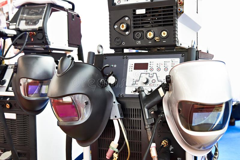 Devices for welding and protective masks. Inverter devices for welding and protective masks stock photography