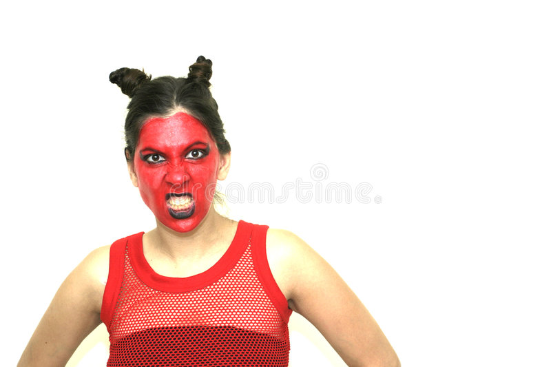 Devil. An angry devilish woman, voluntary slightly overexposed stock images