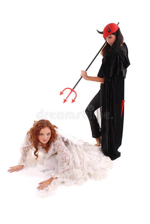 Devil and angel stock photography