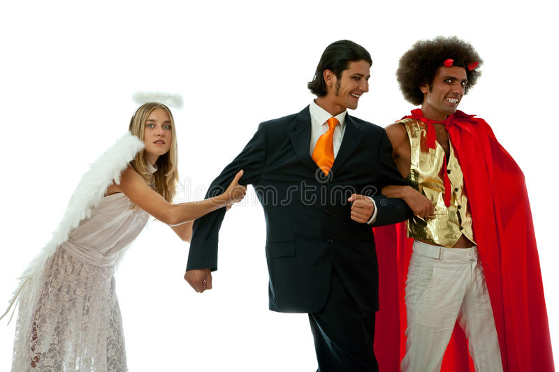 Devil and angel fighting royalty free stock photography