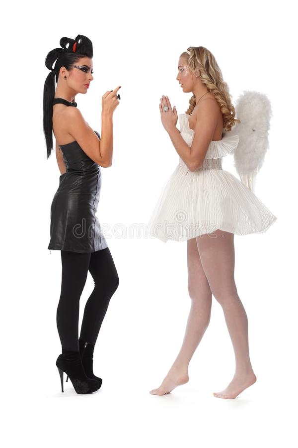 Devil and angel side view royalty free stock photos