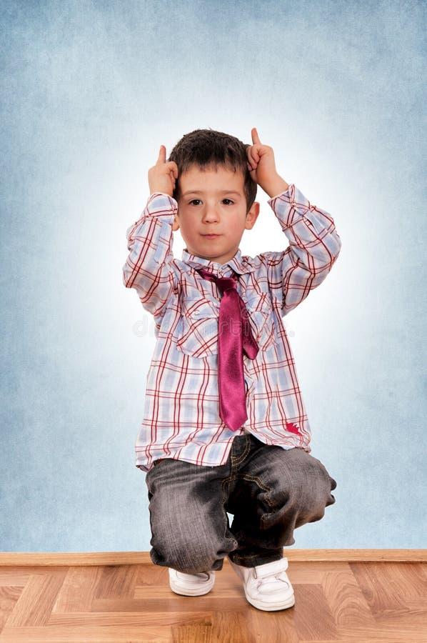 Devil boy stock photography