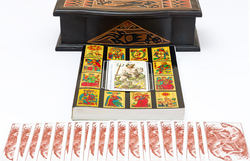 The Devil Card. The book of the Tarot , with foreground The Devil card stock photography