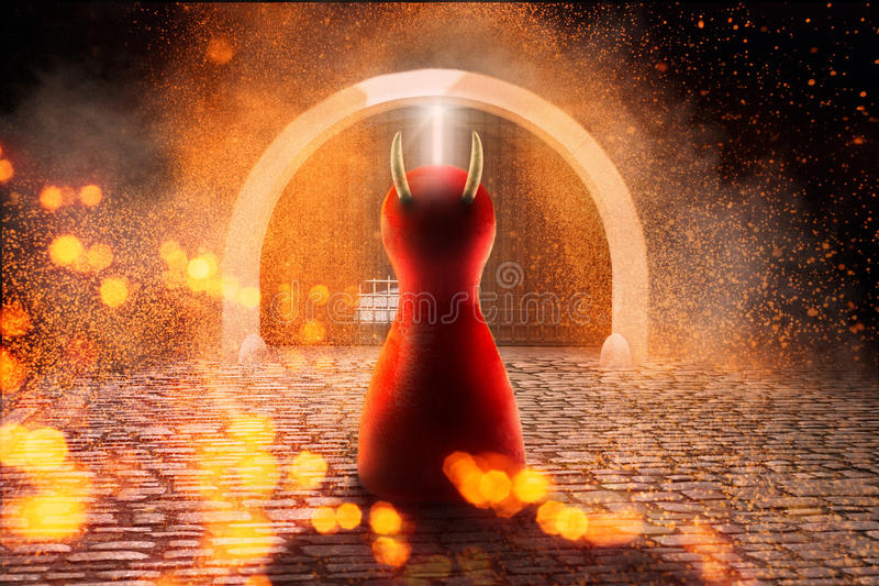 Devil figure in front of the door to the hell. WIth Copy space. royalty free stock images