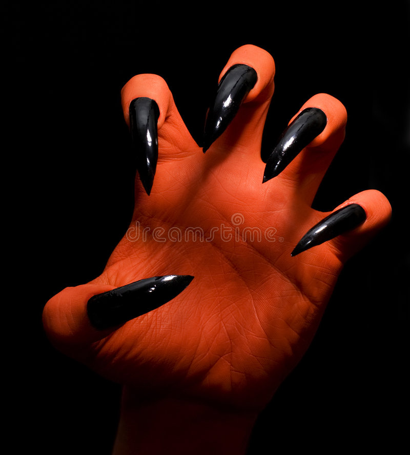 Devil hand royalty free stock images